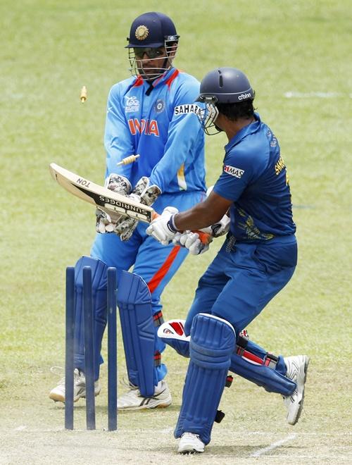 Sri Lanka's Kumar Sangakkara (right) bowled out by India's Harbhajan Singh