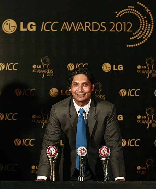Sri Lanka's Kumar Sangakkara poses with his trophies during the ICC Awards in Colombo