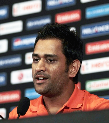India's captain Mahendra Singh Dhoni speaks to reporters