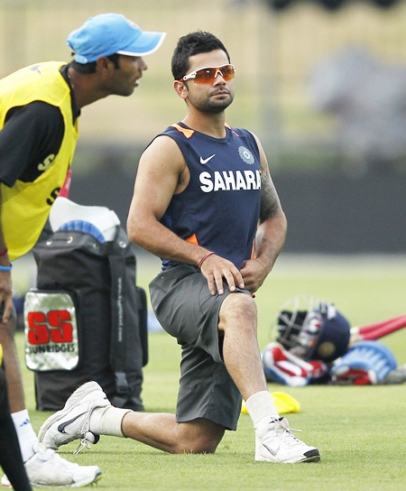 India's vice captain Virat Kohli stretches