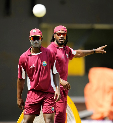 West Indies' captain Darren Sammy (L) and Chris Gayle watch a ball during a training  session