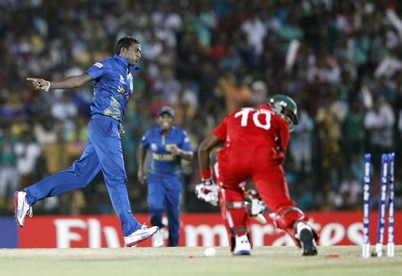 Ajantha Mendis celebrates a wicket