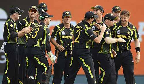 Australia's Shane Watson is congratulated by teammates after dismissing Ireland's Porterfield during the World Twenty20 group B match at the R. Premadasa Stadium, Colombo