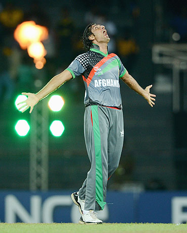 Shapoor Zadran celebrates the wicket of Virender Sehwag