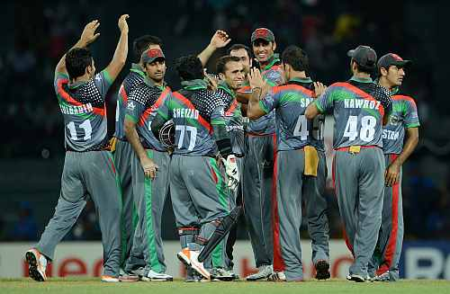 Afghanistan team celebrates after a fall of a wicket