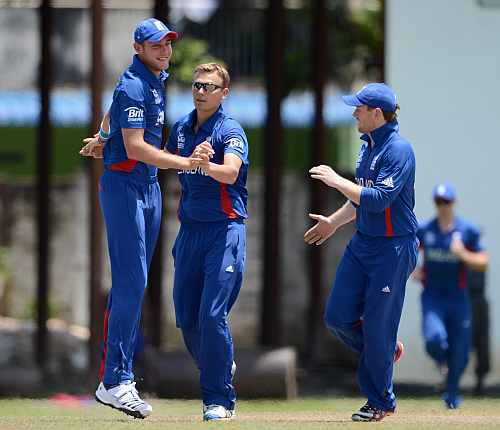 Danny Briggs of England celebrates with Stuart Broad after dismissing Mohammad Hafeez of Pakistan