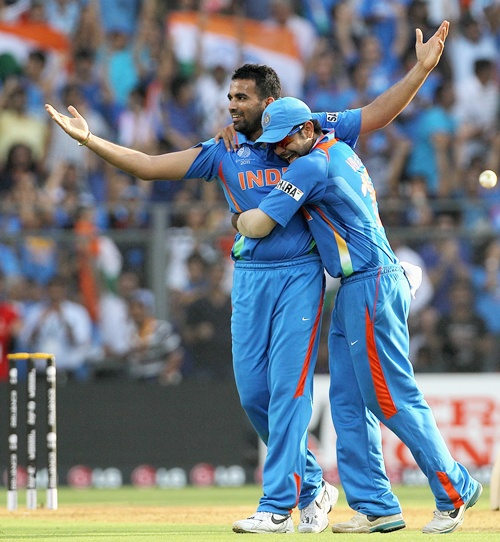 Zaheer Khan (left) of India celebrates with teammate Virat Kohli