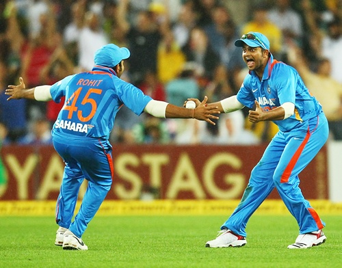 Suresh Raina of India celebrates teammate Rohit Sharma