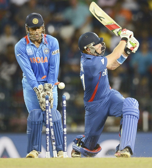 England's Jonny Bairstow (right) is bowled as India's Mahendra Singh Dhoni looks on