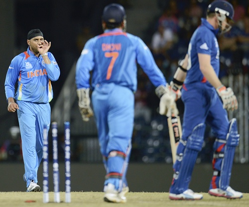 India's Harbhajan Singh (left) gestures after dismissing En