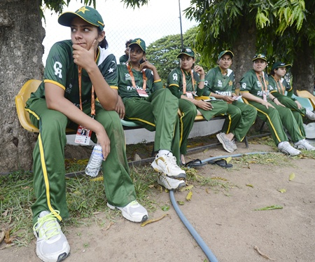 Pakistan's Marina Iqbal (left) and her teammates watch the ICC Women's World Twenty20 warm-up match