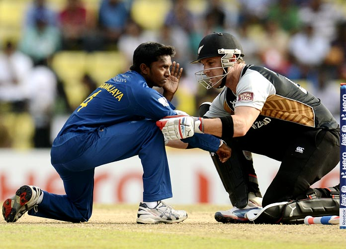 Brendon McCullum (right) speaks to Akila Dananjaya after he was hit on the face