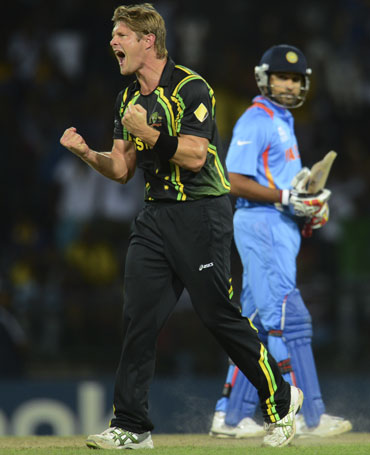 Australia's Shane Watson celebrates after dismissing India's Irfan Pathan (not in picture) as Rohit Sharma looks on