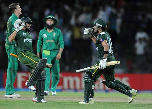 Umar Akmal of Pakistan celebrates as Pakistan wins the super eight match between Pakistan and South Africa
