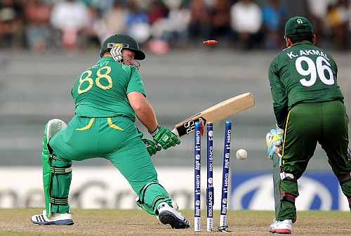 Richard Levi of South Africa is bowled out by Saeed Ajmal of Pakistan during the Super Eight match between Pakistan and South Africa