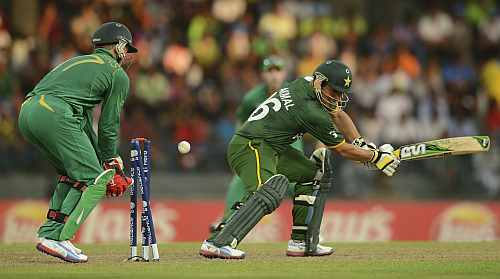 Pakistan's Kamran Akmal is bowled as South Africa's de Villiers looks on during the ICC World Twenty20 Super 8 cricket match at the R. Premadasa Stadium in Colombo