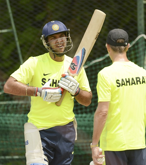 Yuvraj Singh (left) speaks to fielding coach Trevor Penney during a training session