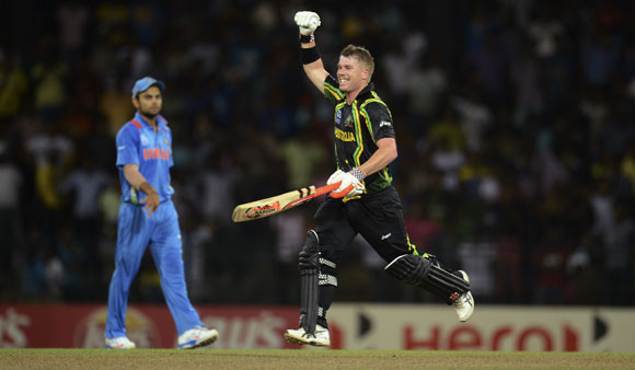 Australia's David Warner celebrates as his team defeat India by 9 wickets in the ICC   World Twenty20 Super 8 cricket match against India at the R Premadasa Stadium in Colombo
