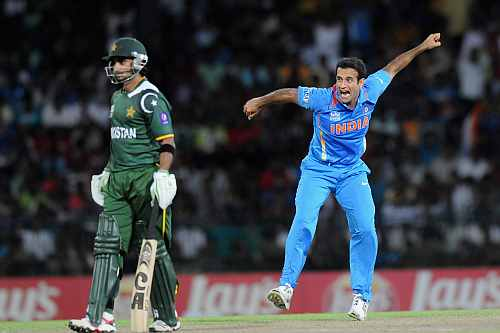Imran Nazir looks on as Irfan Pathan celebrates after taking his wicket during the ICC T20 World Cup, Super Eight group 2 match between Pakistan and India