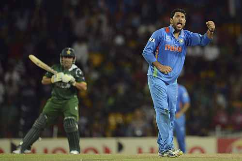 India's Yuvraj Singh celebrates after dismissing Pakistan's Akmal during ICC World Twenty Super 8 match against India at R Premadasa Stadium