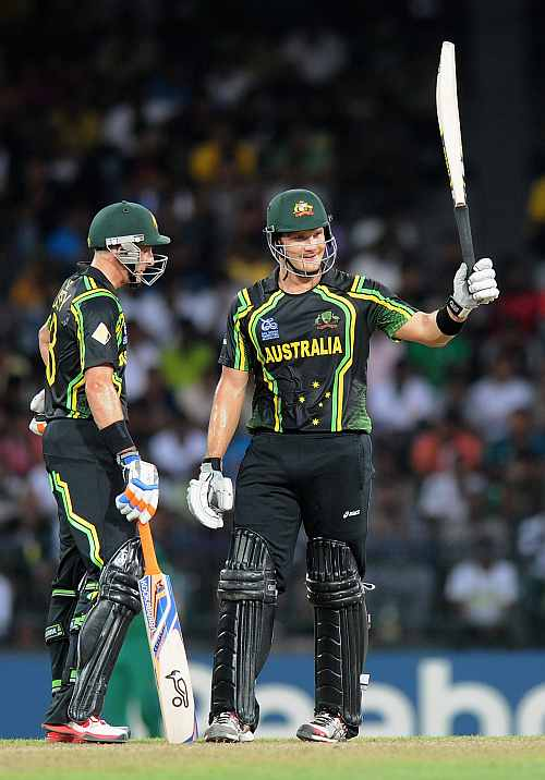 hane Watson of Australia raises his bat after scoring a half century as teammate David Hussey looks on during the Ninth super eight match between Australia and South Africa