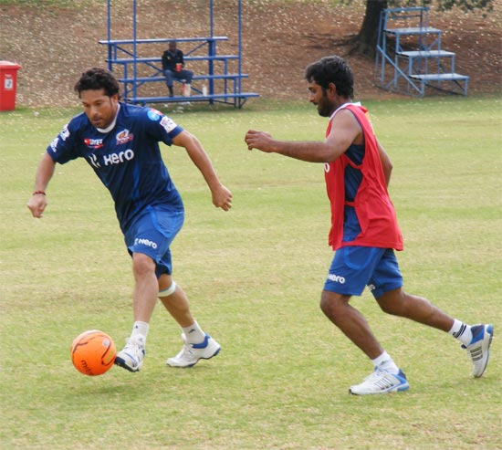 Sachin Tendulkar plays football with team mate Ambati Rayudu