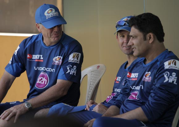 Mumbai Indians coach John Wright (left) speaks to captain Ricky Ponting and chief mentor Anil Kumble