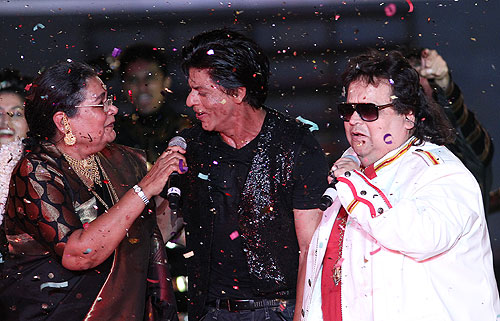 Shah Rukh Khan with Usha Uthup and Bappi Lahiri