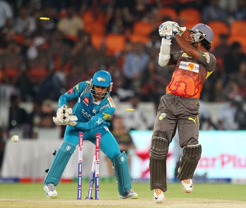Kumar Sangakkara looks behind to find his stumps shattered