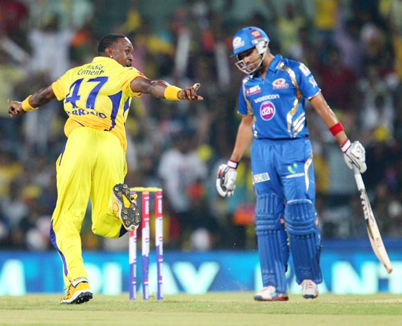 Dwayne Bravo celebrates after taking the wicket of Rohit Sharma