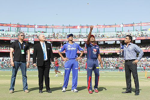 Rajasthan Royals captain Rahul Dravid calls as Delhi Daredevils captain Mahela Jayawardene tosses the coin at the toss on Saturday