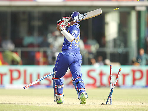 Stuart Binny of Rajasthan Royals is clean bowled by Umesh Yadav