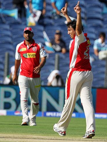 Kings XI Punjab player Azhar Mahmood celebrates a wicket