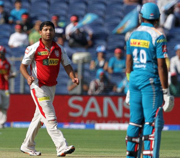 Kings XI Punjab player Piyush Chawla celebrates after getting the wicket of Robin Uthappa