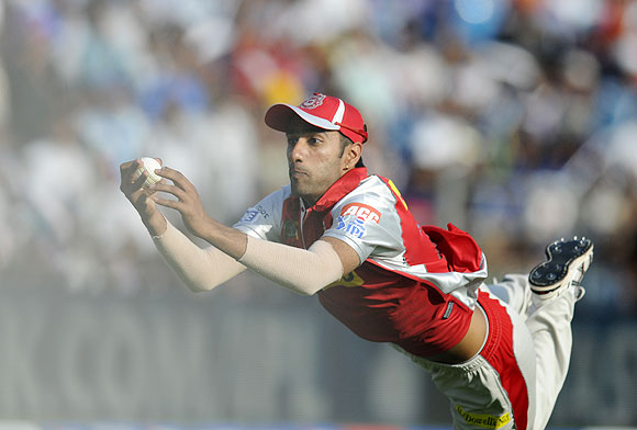 Gurkeerat Mann Singh of Kings XI Punjab dives to take a catch to get Ross Taylor of Pune Warriors out