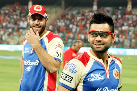 Virat Kohli (right) with Daniel Vettori