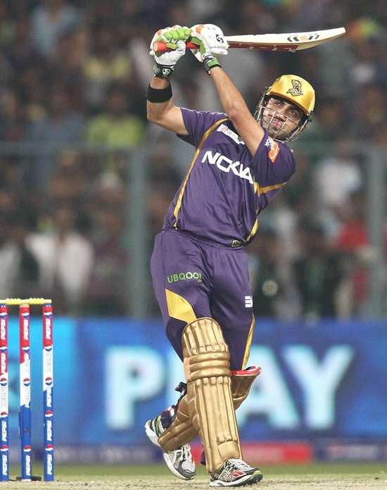 Gautam Gambhir looks on after he hits the ball at an IPL match