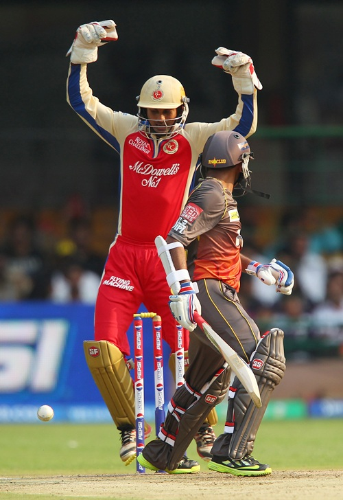 Wicketkeeper Arun Karthik celebrates as Parthiv Patel looks back to find his bails dislodged