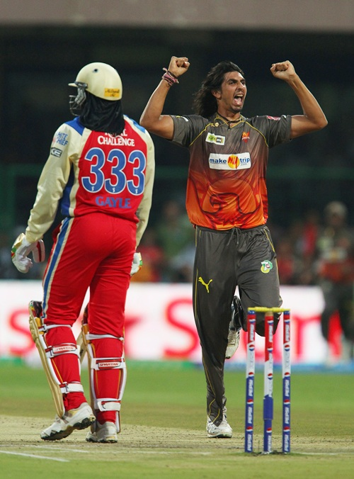 Ishant Sharma celebrates as Chris Gayle walks back