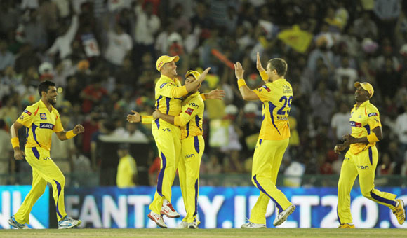 Chennai Super King players celebrates the wicket of Kings XI Punjab captain Adam Gilchrist