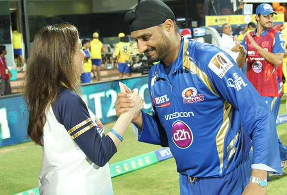 Harbhajan Singh is congratulated by Nita Ambani