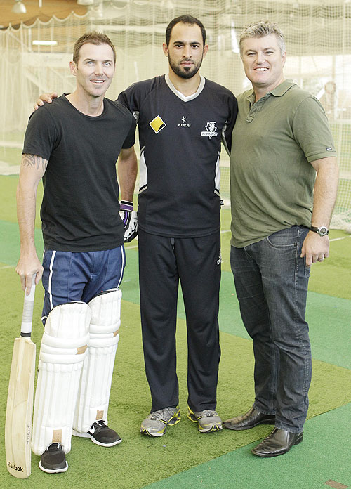 Former Australia cricket players Damien Martyn (left) and Stuart MacGill (right) with Victorian player Fawad Ahmed during a meeting at the Sydney Cricket Ground Indoor Nets on March 28, 2013