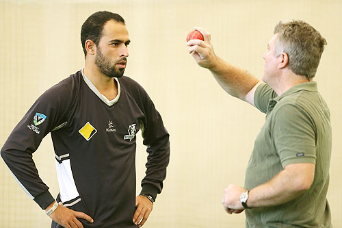 Former Australia cricket player Stuart MacGill (right) chats to Victorian player Fawad Ahmed