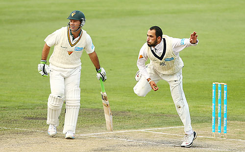 Ricky Ponting of Tasmania backs up as Fawad Ahmed of Victoria bowls