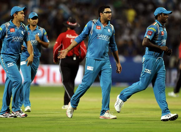 Yuvraj Singh celebrates with team mates after taking the wicket of Stuart Binny