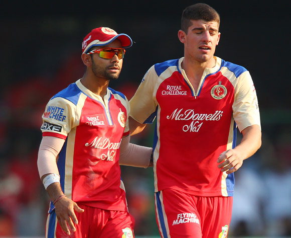 Virat Kohli and Moises Henriques celebrate a wicket