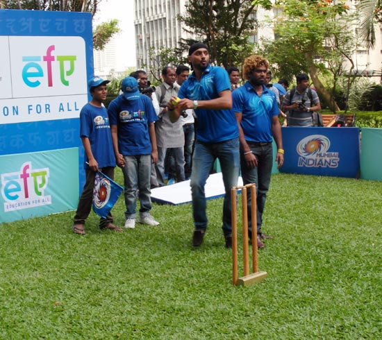Harbhajan Singh prepares to bowl as Lasith Malinga looks on
