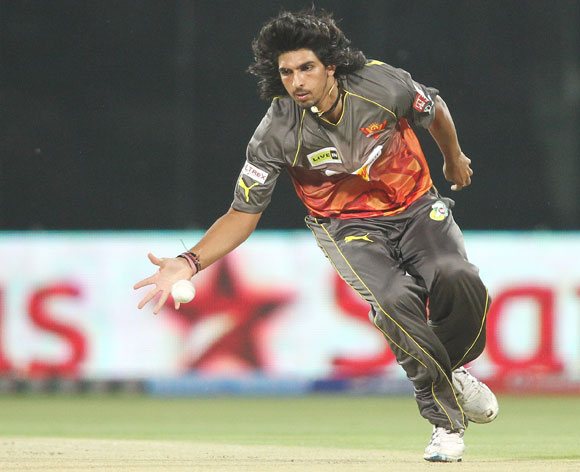 Ishant Sharma of Sunrisers Hyderabad fields the ball off his own bowling