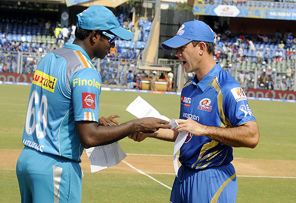 Ricky Ponting captain of Mumbai Indians and Angelo Mathews captain of Pune Warriors exchange teamsheets during the toss before the start of their match at the Wankhede Stadium in Mumbai on Saturday