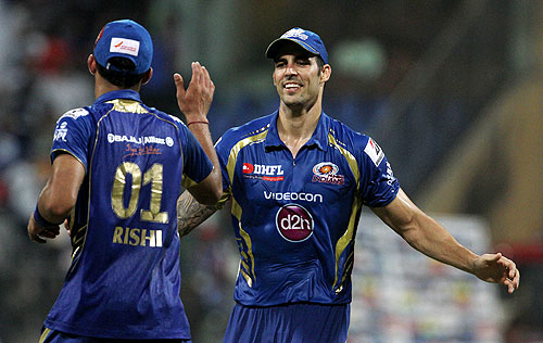 Mitchell Johnson and Rishi Dhawan celebrate after winning